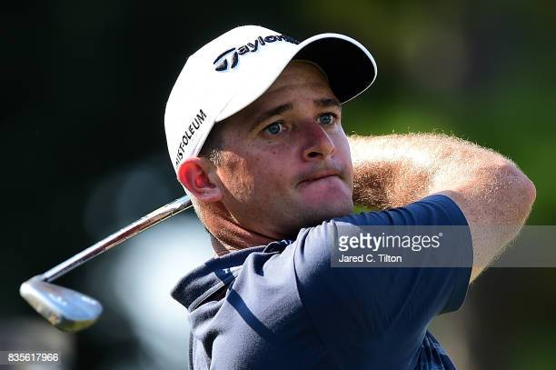Sam Saunders plays his tee shot on the 16th hole during the third round of the Wyndham Championship at Sedgefield Country Club on August 19 2017 in...