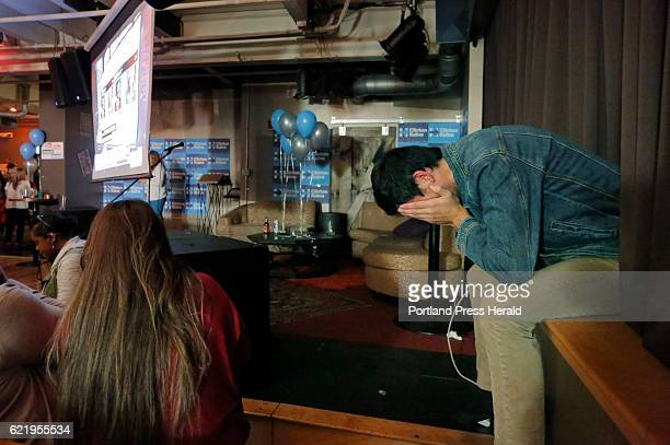 Sam Shapiro holds his head in his hands in despair as results showing Donald Trump taking a significant lead come in late on Tuesday night November 8...