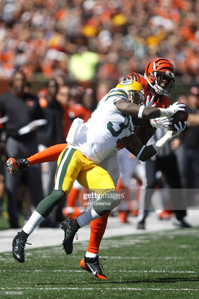 <a gi-track='captionPersonalityLinkClicked' href=/galleries/search?phrase=Sam+Shields&family=editorial&specificpeople=3239570 ng-click='$event.stopPropagation()'>Sam Shields</a> #37 of the Green Bay Packers makes the interception in front of <a gi-track='captionPersonalityLinkClicked' href=/galleries/search?phrase=Brandon+Tate&family=editorial&specificpeople=2212711 ng-click='$event.stopPropagation()'>Brandon Tate</a> #19 of the Cincinnati Bengals during their game at Paul Brown Stadium on September 22, 2013 in Cincinnati, Ohio. The Bengals defeated the Packers 34-30.