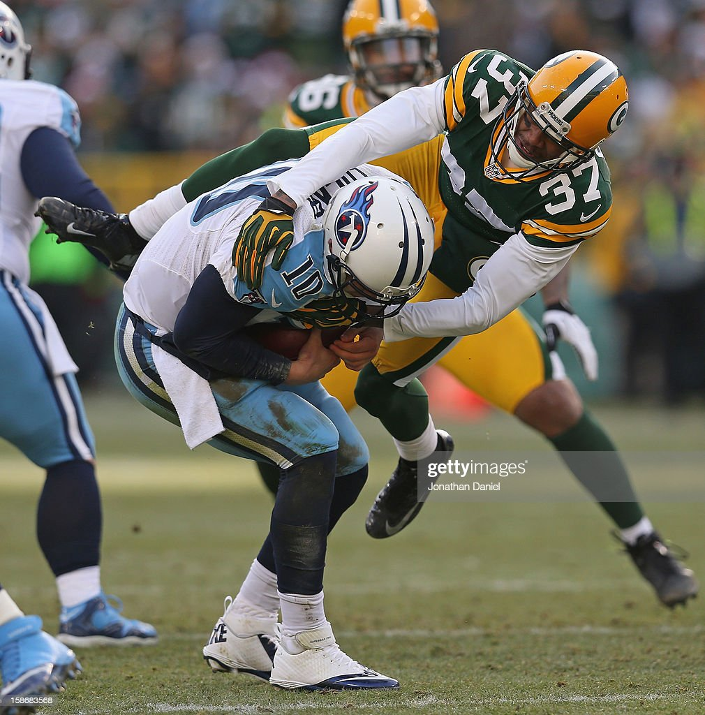 Sam Shields #37 of the Green Bay Packers sacks <a gi-track='captionPersonalityLinkClicked' href=/galleries/search?phrase=Jake+Locker&family=editorial&specificpeople=4450185 ng-click='$event.stopPropagation()'>Jake Locker</a> #10 of the Tennessee Titans at Lambeau Field on December 23, 2012 in Green Bay, Wisconsin. The Packers defeated the Titans 55-7.