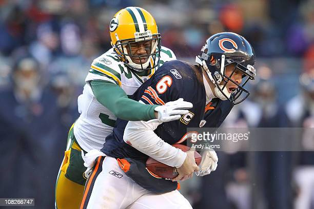 Sam Shields of the Green Bay Packers sacks quarterback Jay Cutler of the Chicago Bears in the second quarter in the NFC Championship Game at Soldier...