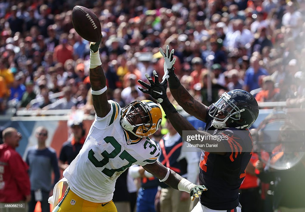 Sam Shields #37 of the Green Bay Packers tips the football away from Alshon Jeffery #17 of the Chicago Bears in the first half at Soldier Field on September 13, 2015 in Chicago, Illinois.