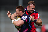 Sam Simmonds of Exeter Chiefs is tackled by Ryan Edwards of Bristol Rugby during the Singha Premiership Rugby 7s Series match between Exeter Chiefs...