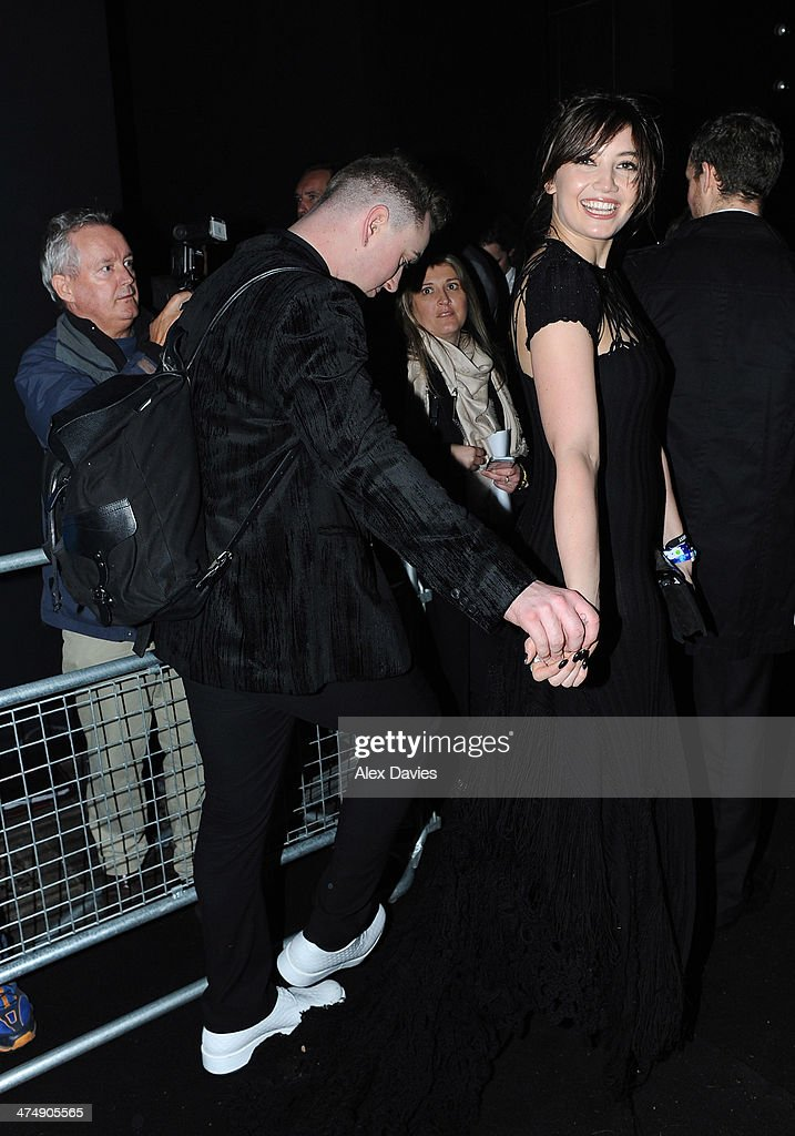 Sam Smith and <a gi-track='captionPersonalityLinkClicked' href=/galleries/search?phrase=Daisy+Lowe&family=editorial&specificpeople=787647 ng-click='$event.stopPropagation()'>Daisy Lowe</a> sighting during the BRIT awards on February 19, 2014 in London, England.