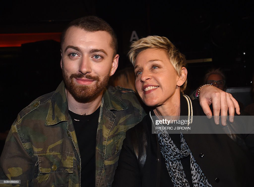 Sam Smith and Ellen DeGeneres attend the Yves Saint Laurent men's fall line and the first part of its women's collection fashion show at the Paladium, in Hollywood, California, February 10, 2016. / AFP / FREDERIC J BROWN