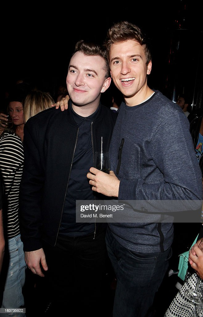 <a gi-track='captionPersonalityLinkClicked' href=/galleries/search?phrase=Sam+Smith+-+Singer&family=editorial&specificpeople=12336931 ng-click='$event.stopPropagation()'>Sam Smith</a> (L) and Greg James attend the launch of The Vinyl Collection curated by Annie Mac and the AMP 2013 album at W London - Leicester Square on October 9, 2013 in London, England.