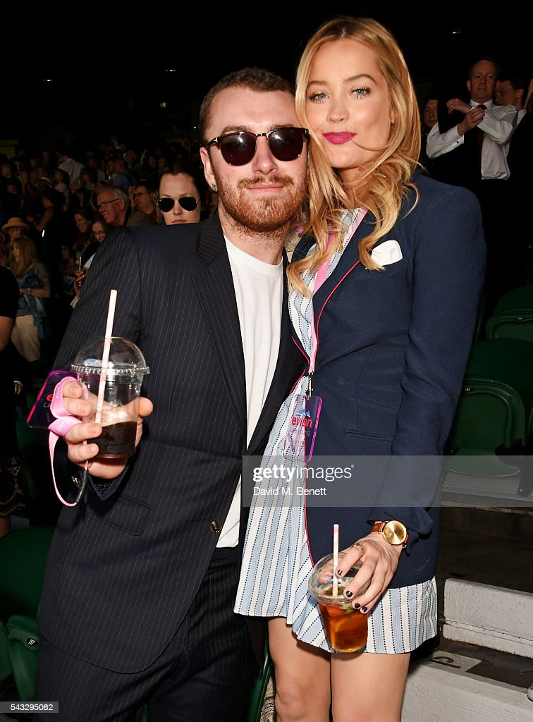 Sam Smith (L) and <a gi-track='captionPersonalityLinkClicked' href=/galleries/search?phrase=Laura+Whitmore&family=editorial&specificpeople=5599316 ng-click='$event.stopPropagation()'>Laura Whitmore</a> attend the evian Live Young suite during Wimbledon 2016 at the All England Tennis and Croquet Club on June 27, 2016 in London, England.