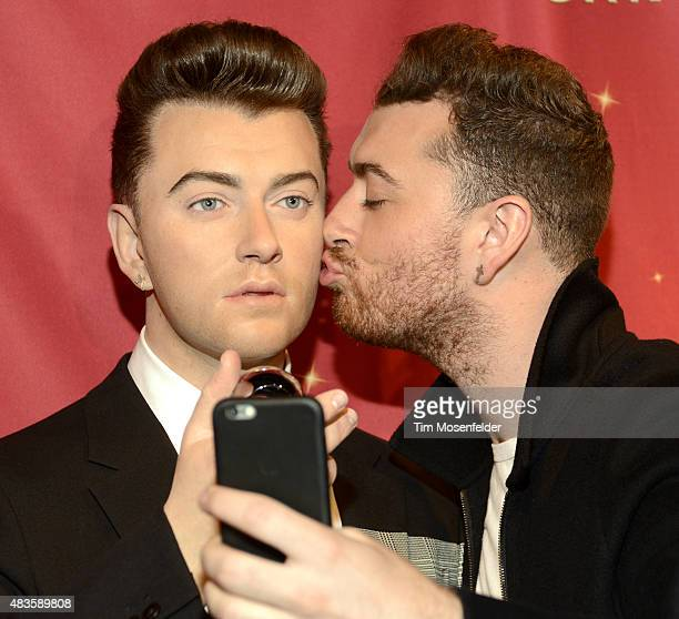 Sam Smith attends an event to present a wax figurine of the vocalist at Madame Tussauds San Francisco on August 10 2015 in San Francisco California