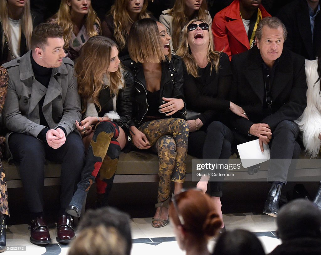 Sam Smith, Cara Delevingne, Jourdan Dunn, Kate Moss and Mario Testino attend the Burberry Prorsum AW 2015 show during London Fashion Week at Kensington Gardens on February 23, 2015 in London, England.