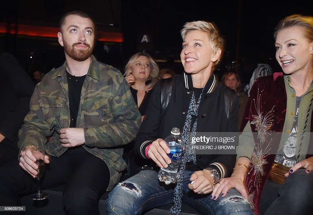 Sam Smith, Ellen DeGeneres and Portia de Rossi attend the Saint Laurent men's fall line and the first part of its women's collection fashion show at the Paladium, in Hollywood, California, February 10, 2016. / AFP / FREDERIC J BROWN