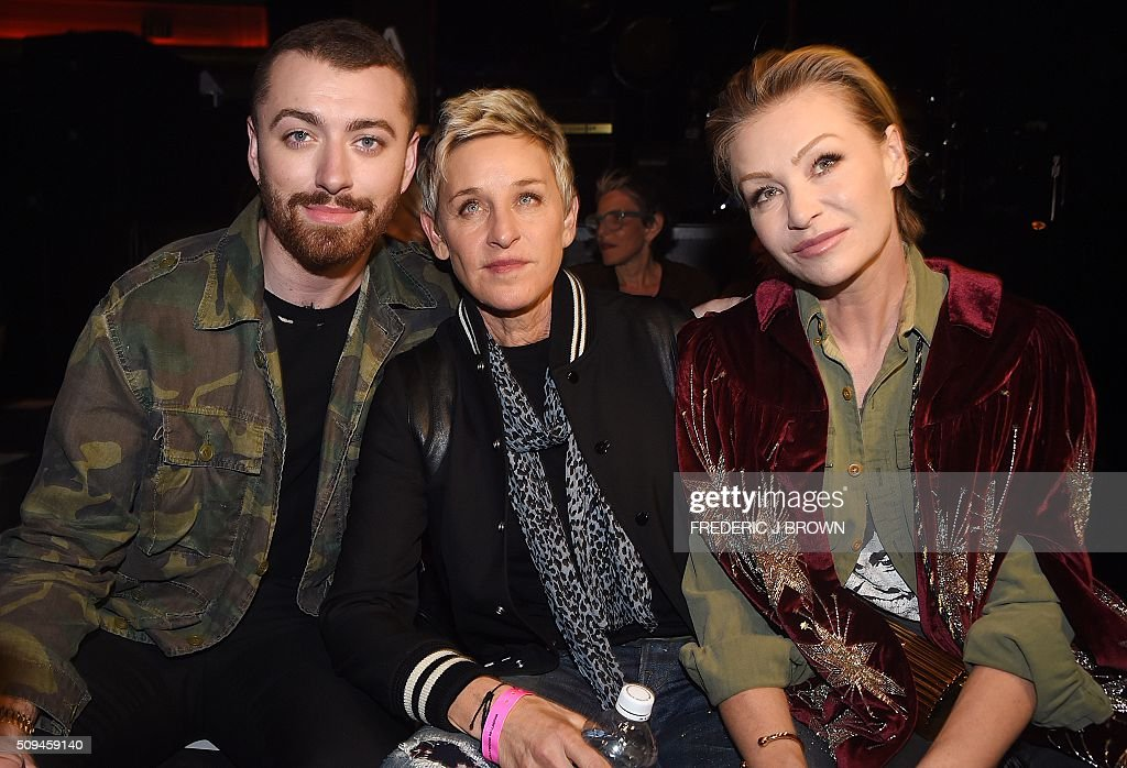 Sam Smith, Ellen DeGeneres and Portia de Rossi (R) attend the Yves Saint Laurent men's fall line and the first part of its women's collection fashion show at the Paladium, in Hollywood, California, February 10, 2016. / AFP / FREDERIC J BROWN