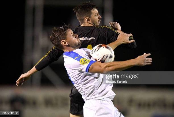 Sam Smith of Gold Coast City and Alex Janovsky of Moreton Bay challenge for the ball during the FFA Cup round of 16 match between Moreton Bay United...