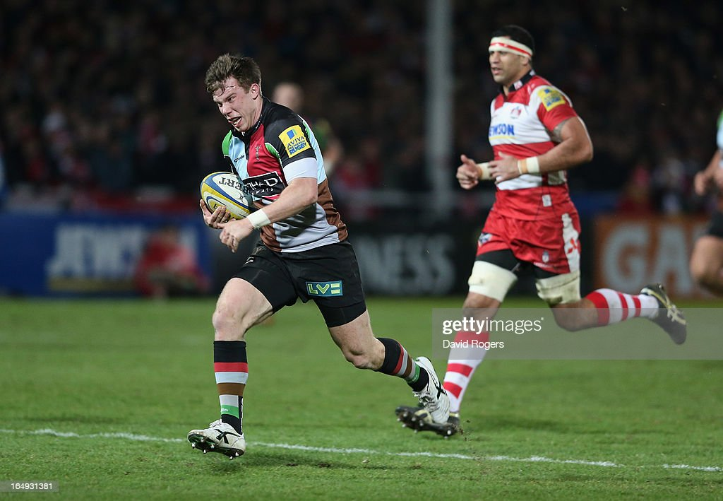 Sam Smith of Harlequins breaks clear to score the second try during the Aviva Premiership match between Gloucester and Harlequins at Kingsholm Stadium on March 29, 2013 in Gloucester, England.