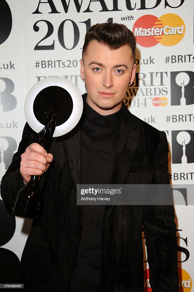 <a gi-track='captionPersonalityLinkClicked' href=/galleries/search?phrase=Sam+Smith+-+Singer&family=editorial&specificpeople=12336931 ng-click='$event.stopPropagation()'>Sam Smith</a>, winner of the Critics' Choice Award, poses in the winners room at The BRIT Awards 2014 at 02 Arena on February 19, 2014 in London, England.