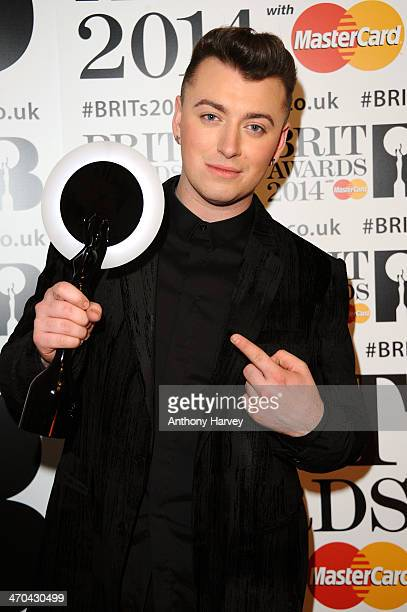 Sam Smith winner of the Critics' Choice Award poses in the winners room at The BRIT Awards 2014 at 02 Arena on February 19 2014 in London England