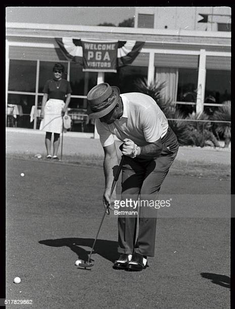 Sam Snead looking more like a croquet player with his new putting prior to playing a round over the Pecan Valley Country Club course where the 50th...