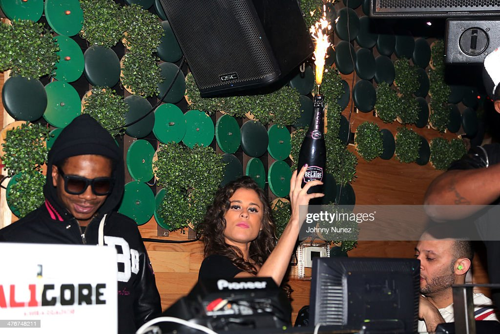 DJ Sam Sneak (L) spins at the 'Mastermind' Album Release Party at Greenhouse on March 4, 2014 in New York City.
