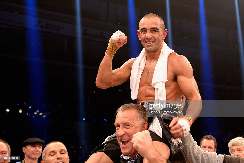 <a gi-track='captionPersonalityLinkClicked' href=/galleries/search?phrase=Sam+Soliman&family=editorial&specificpeople=2490033 ng-click='$event.stopPropagation()'>Sam Soliman</a> of Australia celebrates after his IBF Middleweight Eliminator fight against Felix Sturm of Germany at ISS Dome on February 1, 2013 in Duesseldorf, Germany.
