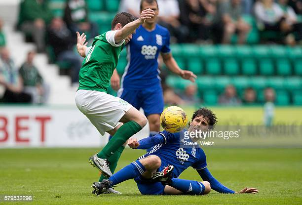 Sam Stanton of Hibernian challenges Diego Fabrini of Birmingham City during the PreSeason Friendly between Hibernian and Birmingham City at Easter...