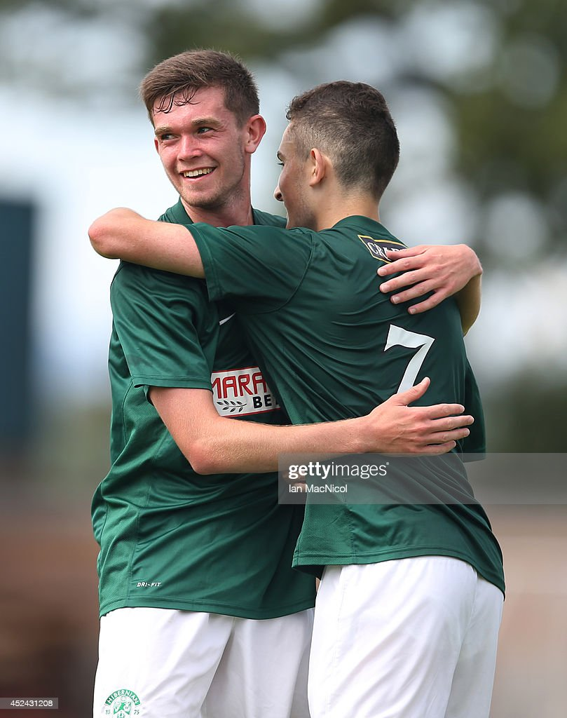 Sam Stanton of Hibernian congratulates Alex Harris of Hibernian on his goal during the Pre Season Friendly match between Stirling Albion and Hibernian at Forthbank Stadium on July 20, 2014 in Stirling, Scotland.