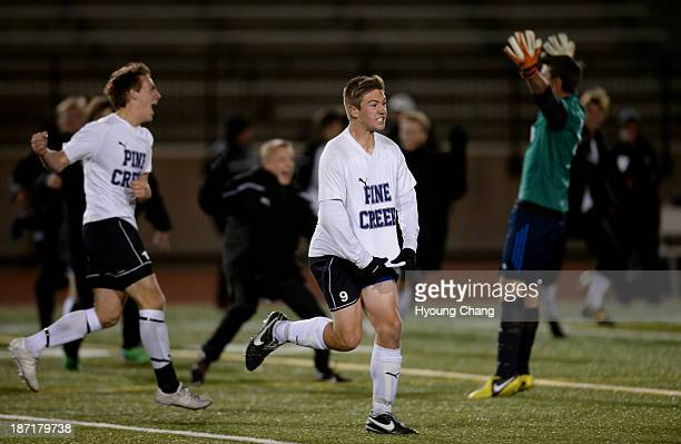Sam Stark of Pine Creek High School and the teammates celebrate winning of 5A boy's soccer semifinal game against boulder High School at Legacy...