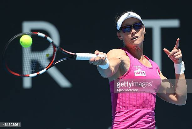 Sam Stosur of Australia hits a forehand in her second round match against Kristina Mladenovic of France during day four of the Moorilla Hobart...