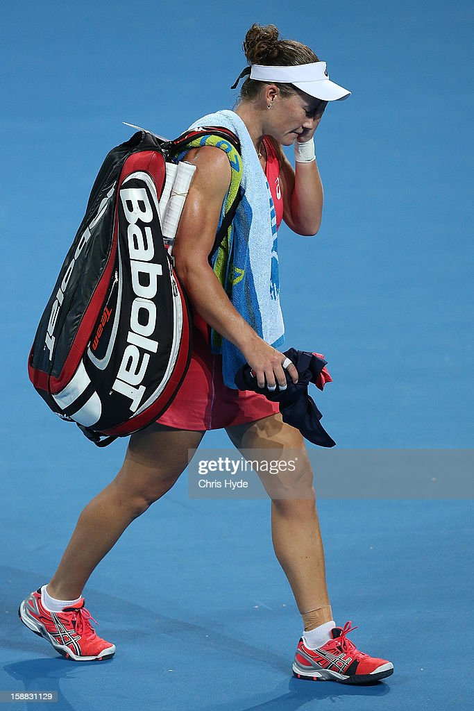 Sam Stosur of Australia leaves the court after losing her match against Sofia Arvidsson of Sweden during day two of the Brisbane International at Pat Rafter Arena on December 31, 2012 in Brisbane, Australia.