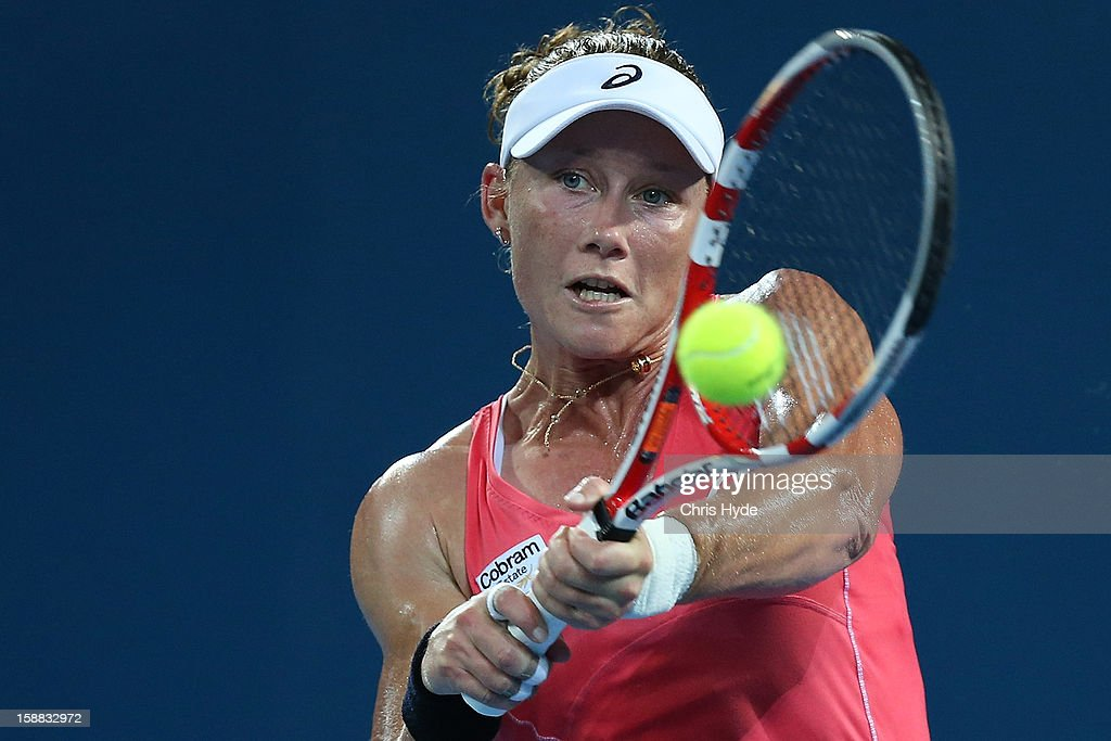 Sam Stosur of Australia plays a backhand in her match against Sofia Arvidsson of Sweden during day two of the Brisbane International at Pat Rafter Arena on December 31, 2012 in Brisbane, Australia.