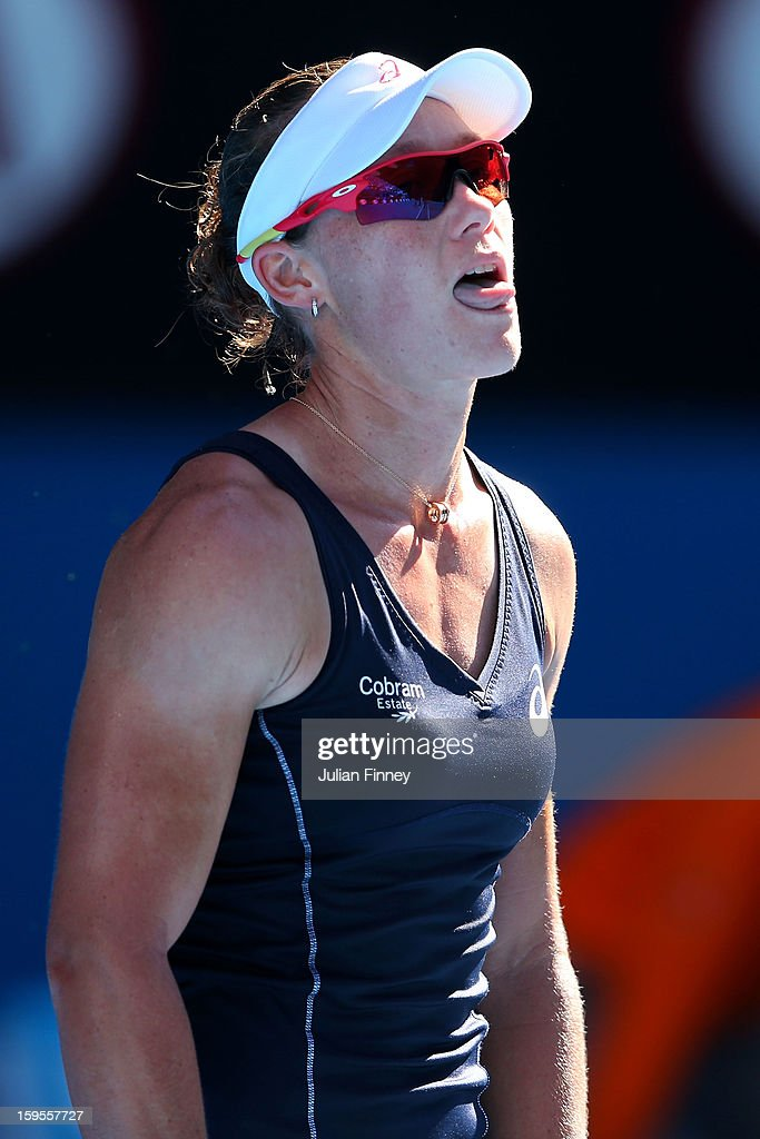 Sam Stosur of Australia reacts in her second round match against Jie Zheng of China during day three of the 2013 Australian Open at Melbourne Park on January 16, 2013 in Melbourne, Australia.