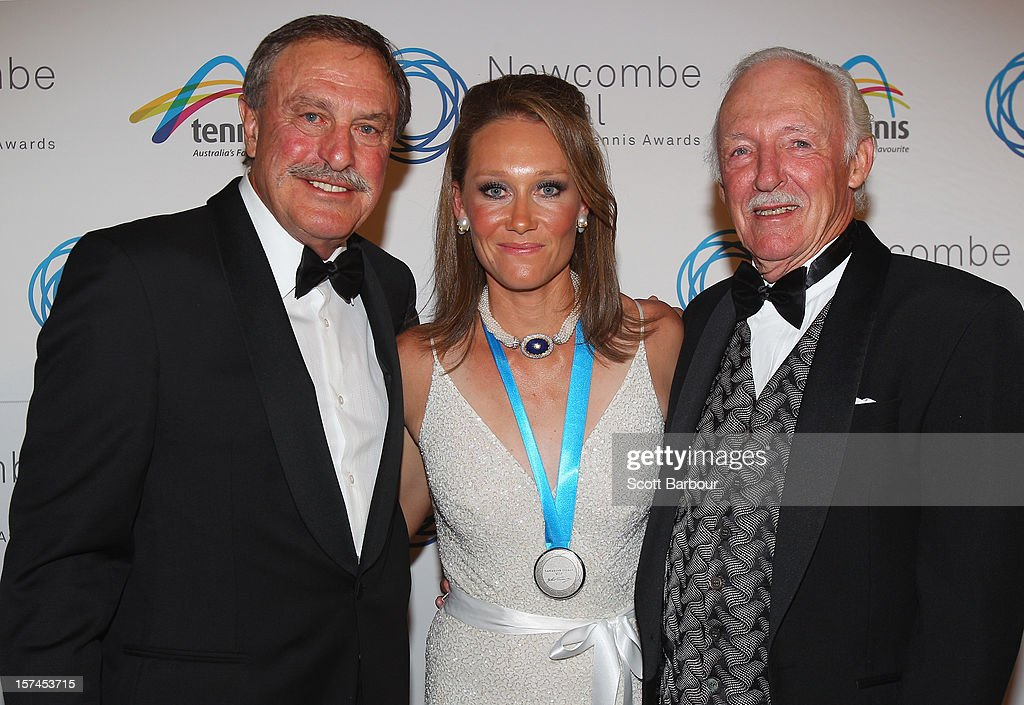Sam Stosur (C) poses with John Newcombe (L) after she won the Newcombe Medal along with Ian Barclay, who was awarded the President's Spirit of Tennis Award for his continued contribution to the sport during the 2012 John Newcombe Medal at Crown Palladium on December 3, 2012 in Melbourne, Australia.