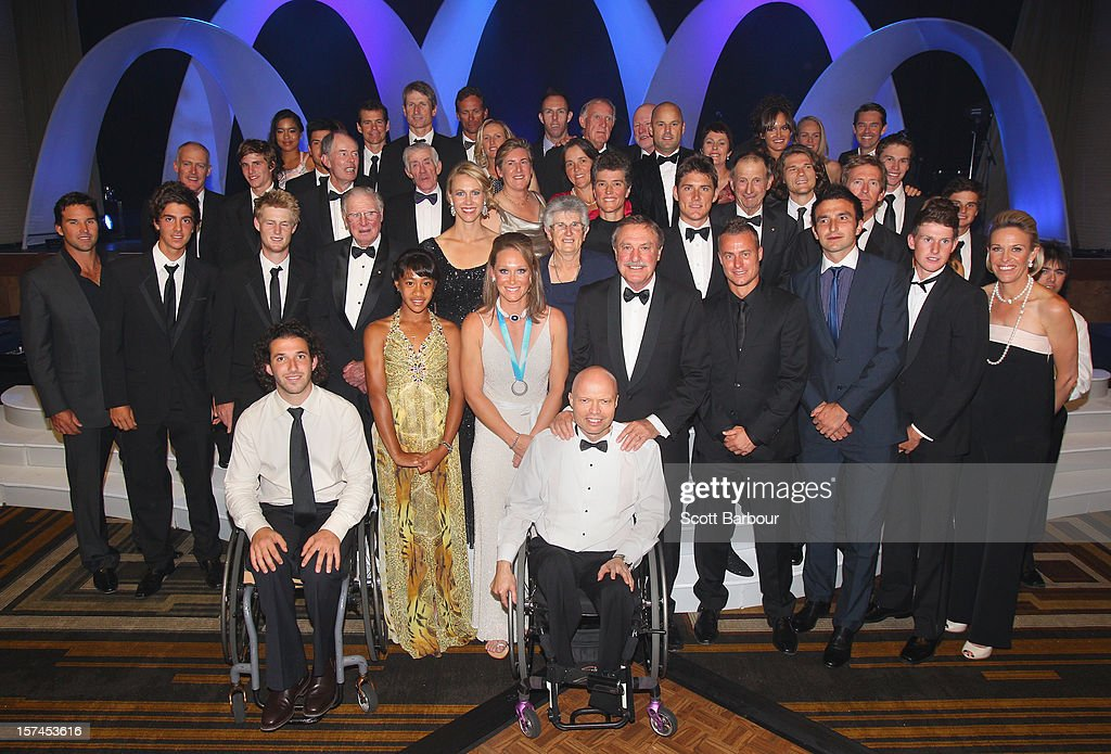 Sam Stosur poses with past and current Australian tennis players after she won the Newcombe Medal during the 2012 <a gi-track='captionPersonalityLinkClicked' href=/galleries/search?phrase=John+Newcombe&family=editorial&specificpeople=221457 ng-click='$event.stopPropagation()'>John Newcombe</a> Medal at Crown Palladium on December 3, 2012 in Melbourne, Australia.