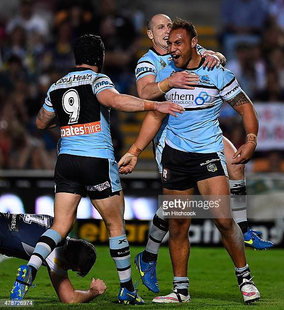 Sam Tagataese of the Sharks celebrates after scoring a try with Jeff Robson and Michael Ennis of the Sharks during the round 16 NRL match between the...