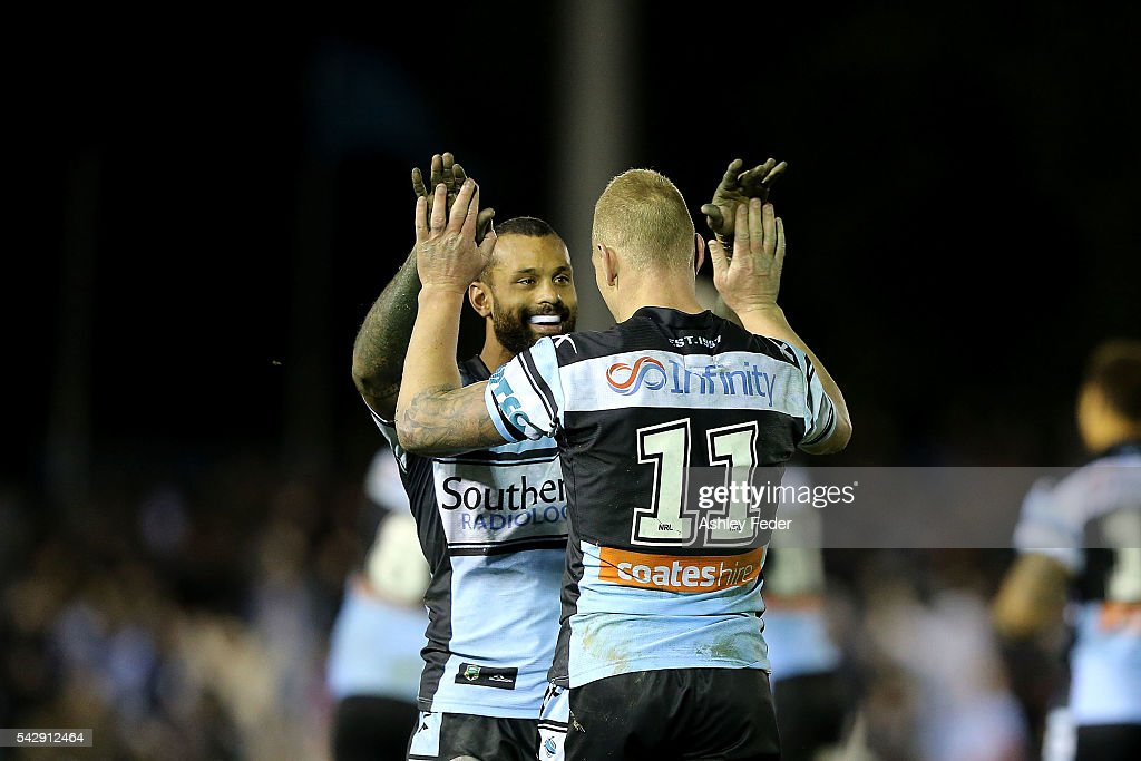 Sam Tagataese of the Sharks celebrates the golden point win with Luke Lewis of the Sharks during the round 16 NRL match between the Cronulla Sharks and the New Zealand Warriors at Southern Cross Group Stadium on June 25, 2016 in Sydney, Australia.
