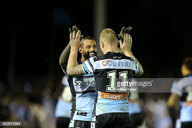Sam Tagataese of the Sharks celebrates the golden point win with Luke Lewis of the Sharks during the round 16 NRL match between the Cronulla Sharks...
