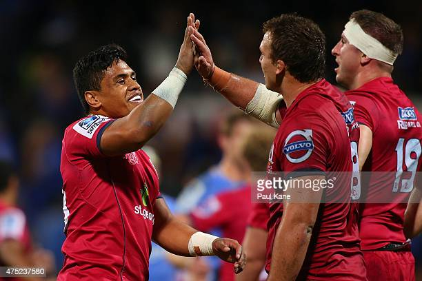 Sam Talakai and Jake Schatz of the Reds celebrate after winning the round 16 Super Rugby match between the Western Force and the Queensland Reds at...