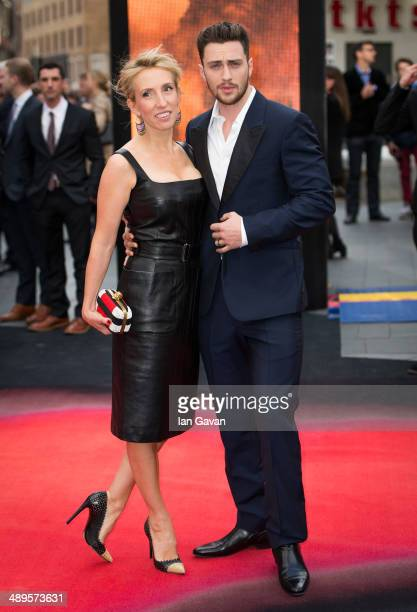 Sam Taylor Wood and Aaron Taylor Johnson attends the European premiere of 'Godzilla' at the Odeon Leicester Square on May 11 2014 in London England
