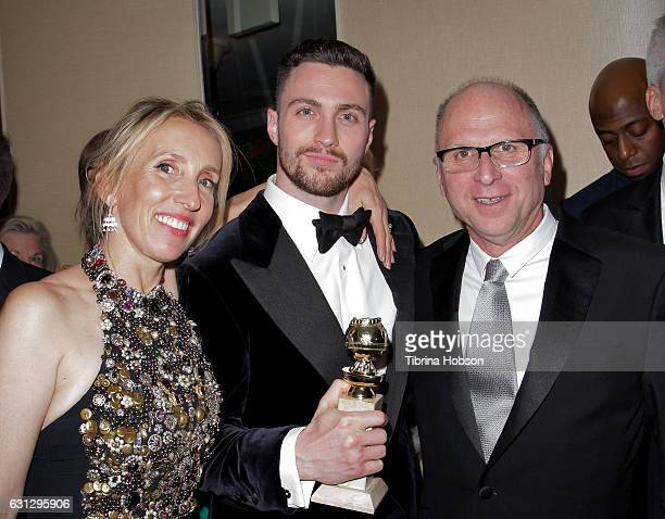 Sam TaylorJohnson Aaron TaylorJohnson and Bob Berney attend Amazon Studios Golden Globes Party at The Beverly Hilton Hotel on January 8 2017 in...