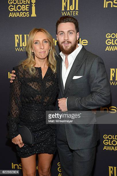 Sam TaylorJohnson and Aaron TaylorJohnson arrive at the Hollywood Foreign Press Association and InStyle celebrate the 2017 Golden Globe Award Season...