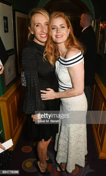 Sam TaylorJohnson and Amy Adams attend a pre BAFTA party hosted by Charles Finch and Chanel at Annabel's on February 11 2017 in London England