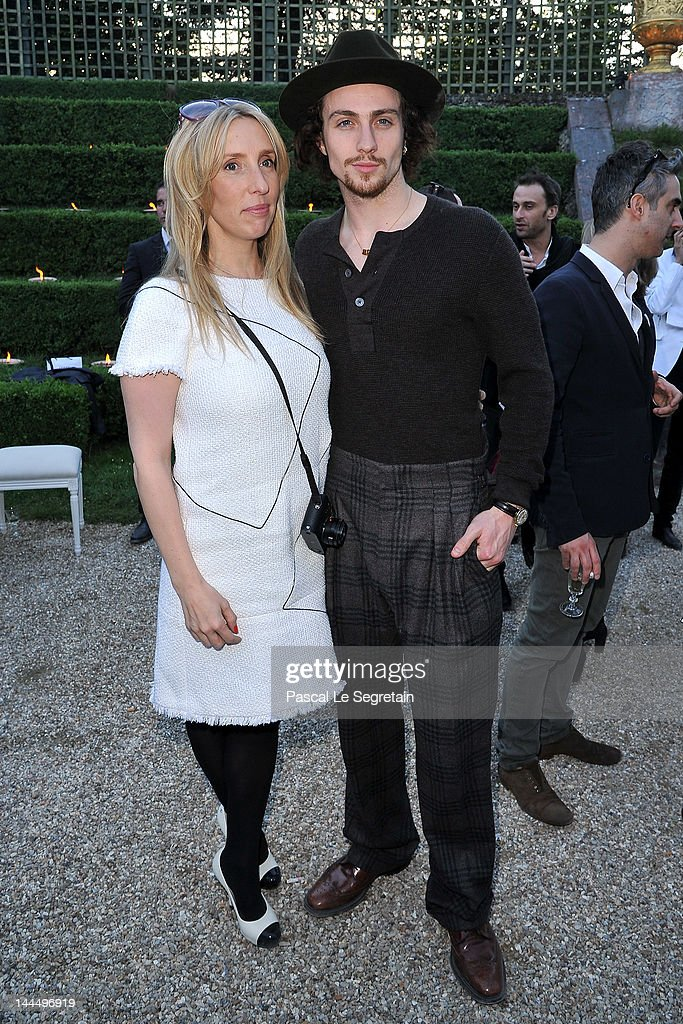 <a gi-track='captionPersonalityLinkClicked' href=/galleries/search?phrase=Sam+Taylor-Wood&family=editorial&specificpeople=206600 ng-click='$event.stopPropagation()'>Sam Taylor-Wood</a> and Aaron Johnson pose during the Chanel 2012/13 Cruise Collection at Chateau de Versailles on May 14, 2012 in Versailles, France.