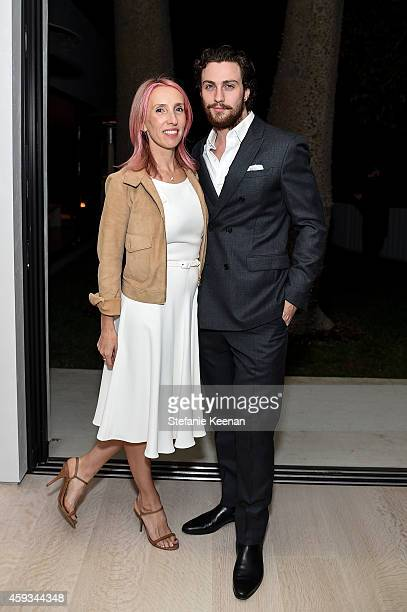 Sam TaylorWood and Aaron TaylorJohnson attend NETAPORTER Celebrates Rosetta Getty on November 20 2014 in Los Angeles California