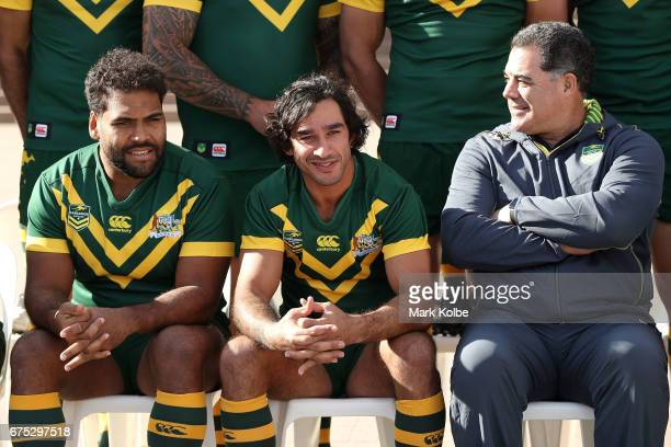 Sam Thaida Johnathan Thurston and Mal Meniga watch on as they pose for a team photo during an Australian Kangaroos media opportunity at the...