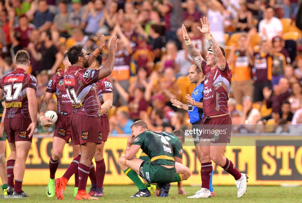 Sam Thaiday and Josh McGuire of the Broncos celebrate victory after the round four NRL match between the Brisbane Broncos and the Canberra Raiders at Suncorp Stadium on March 24, 2017 in Brisbane, Australia.