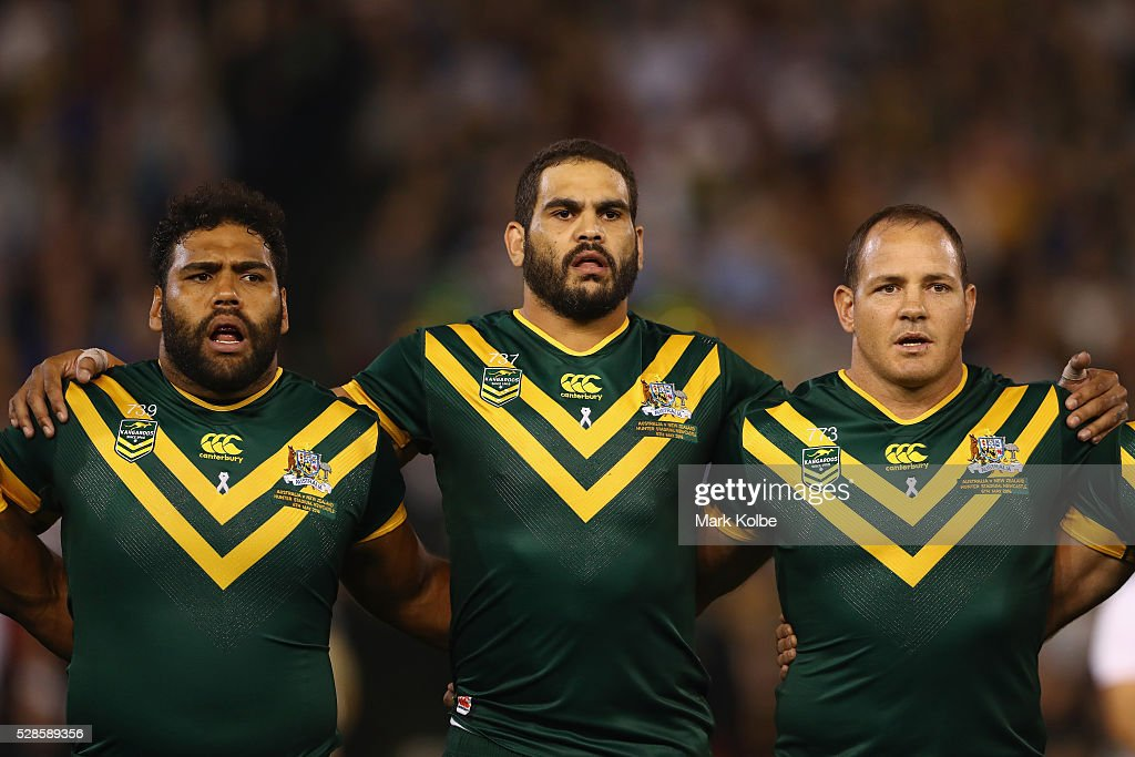 <a gi-track='captionPersonalityLinkClicked' href=/galleries/search?phrase=Sam+Thaiday&family=editorial&specificpeople=540245 ng-click='$event.stopPropagation()'>Sam Thaiday</a>, <a gi-track='captionPersonalityLinkClicked' href=/galleries/search?phrase=Greg+Inglis&family=editorial&specificpeople=597192 ng-click='$event.stopPropagation()'>Greg Inglis</a> and Matt Scott of the Kangaroos sing the national anthem during the International Rugby League Trans Tasman Test match between the Australian Kangaroos and the New Zealand Kiwis at Hunter Stadium on May 6, 2016 in Newcastle, Australia.