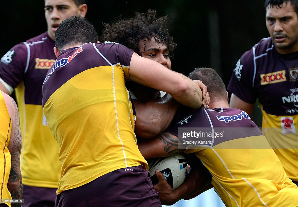 <a gi-track='captionPersonalityLinkClicked' href=/galleries/search?phrase=Sam+Thaiday&family=editorial&specificpeople=540245 ng-click='$event.stopPropagation()'>Sam Thaiday</a> is wrapped up by the defence during a Brisbane Broncos NRL training session on February 28, 2013 in Brisbane, Australia.