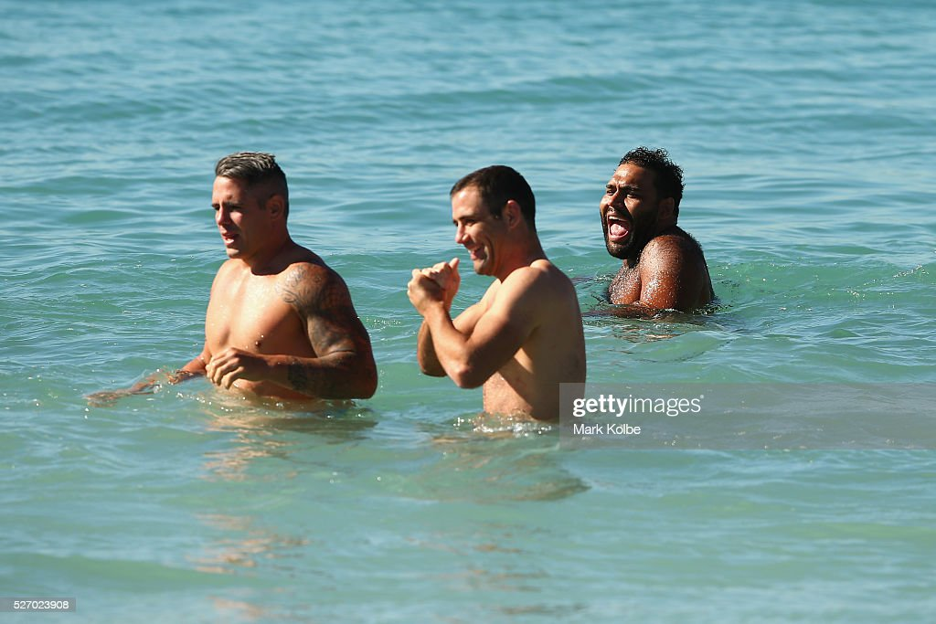 <a gi-track='captionPersonalityLinkClicked' href=/galleries/search?phrase=Sam+Thaiday&family=editorial&specificpeople=540245 ng-click='$event.stopPropagation()'>Sam Thaiday</a> laughs as he walks in the water during stretching at the Australia Kangaroos Test team recovery session at Coogee Beach on May 2, 2016 in Sydney, Australia.