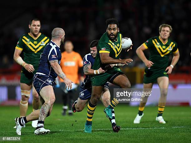 Sam Thaiday of Australia breaks throught the tackle of Liam Hood of Scotland during the Four Nations match between the Australian Kangaroos and...
