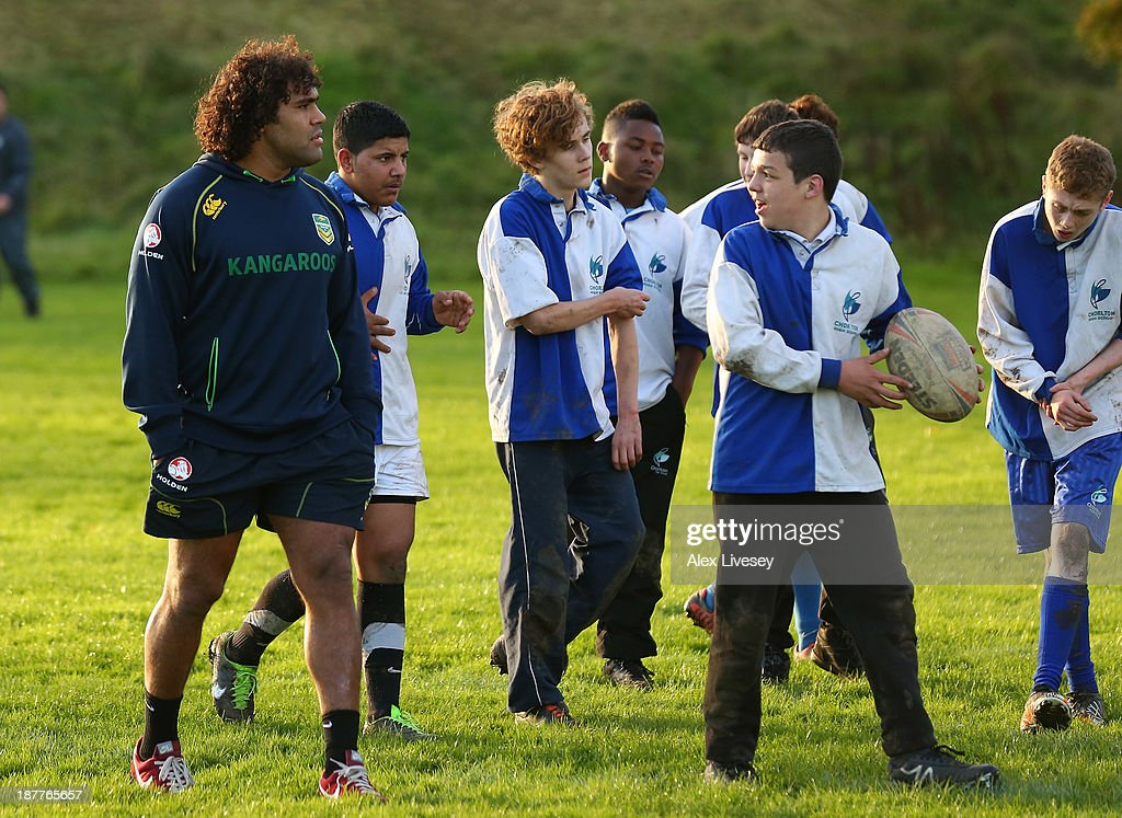 <a gi-track='captionPersonalityLinkClicked' href=/galleries/search?phrase=Sam+Thaiday&family=editorial&specificpeople=540245 ng-click='$event.stopPropagation()'>Sam Thaiday</a> of Australia gives out coaching tips to school boys from seven different schools to help kick off the Mancunians inaugural Year 10 tournament the largest Rugby League schools event held in the city of Manchester at Parrswood High School on November 12, 2013 in Manchester, England.