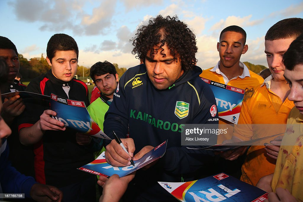 <a gi-track='captionPersonalityLinkClicked' href=/galleries/search?phrase=Sam+Thaiday&family=editorial&specificpeople=540245 ng-click='$event.stopPropagation()'>Sam Thaiday</a> of Australia signs autographs after giving out coaching tips to school boys from seven different schools to help kick off the Mancunians inaugural Year 10 tournament the largest Rugby League schools event held in the city of Manchester at Parrswood High School on November 12, 2013 in Manchester, England.