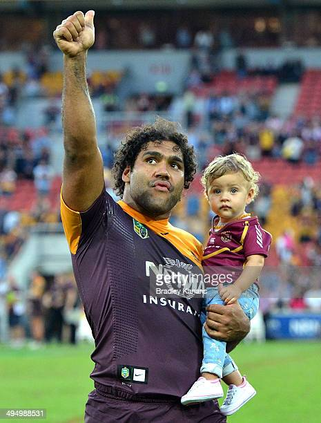 Sam Thaiday of the Broncos celebrates victory with fans as he holds his young daughter Gracie after the round 12 NRL match between the Brisbane...